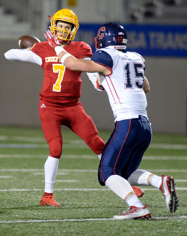 . Palma quarterback Zach Flores works under pressure from Campolindo\'s Justin Ehrenberger during the Northern California Division 4 AA championship football game at Rabobank Stadium in Salinas on Friday December 9, 2016. (David Royal - Monterey Herald)