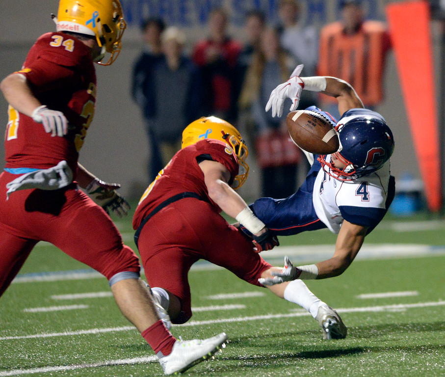 . Palma\'s Tristan Wahl, center, upends Campolindo\'s Kannah Cruickshank, right, allowing Palma\'s Stanley Smith to recover the fumble during the Northern California Division 4 AA championship football game at Rabobank Stadium in Salinas on Friday December 9, 2016. (David Royal - Monterey Herald)