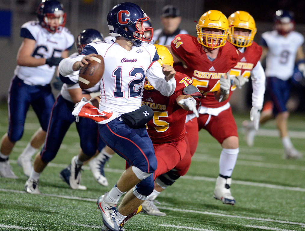 . Campolindo quarterback Jacob Westphal is pressured by Palma\'s Richard Hernandez during the Northern California Division 4 AA championship football game at Rabobank Stadium in Salinas on Friday December 9, 2016. (David Royal - Monterey Herald)