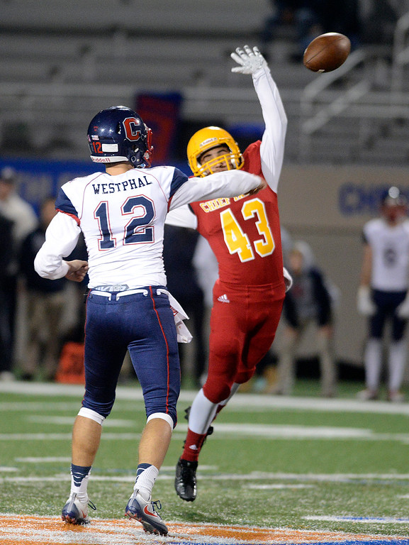 . Palma\'s Michael Zaragoza tries to block a pass by Campolindo quarterback Jacob Westphal during the Northern California Division 4 AA championship football game at Rabobank Stadium in Salinas on Friday December 9, 2016. (David Royal - Monterey Herald)