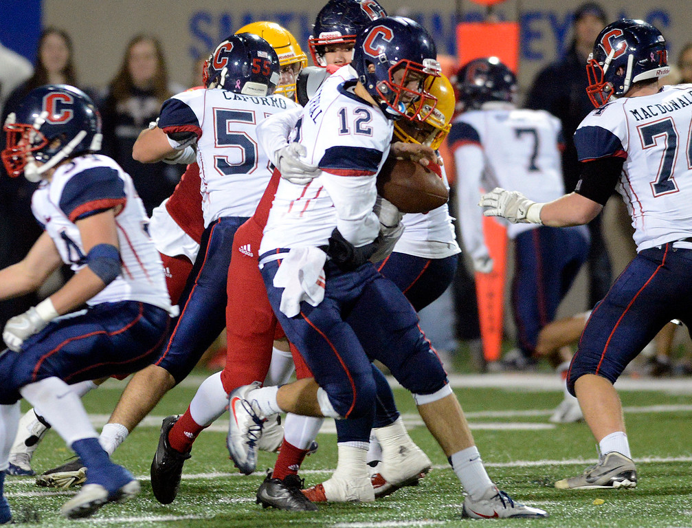 . Palma\'s Miguel Zaragoza sacks Campolindo quarterback Jacob Westphal during the Northern California Division 4 AA championship football game at Rabobank Stadium in Salinas on Friday December 9, 2016. (David Royal - Monterey Herald)