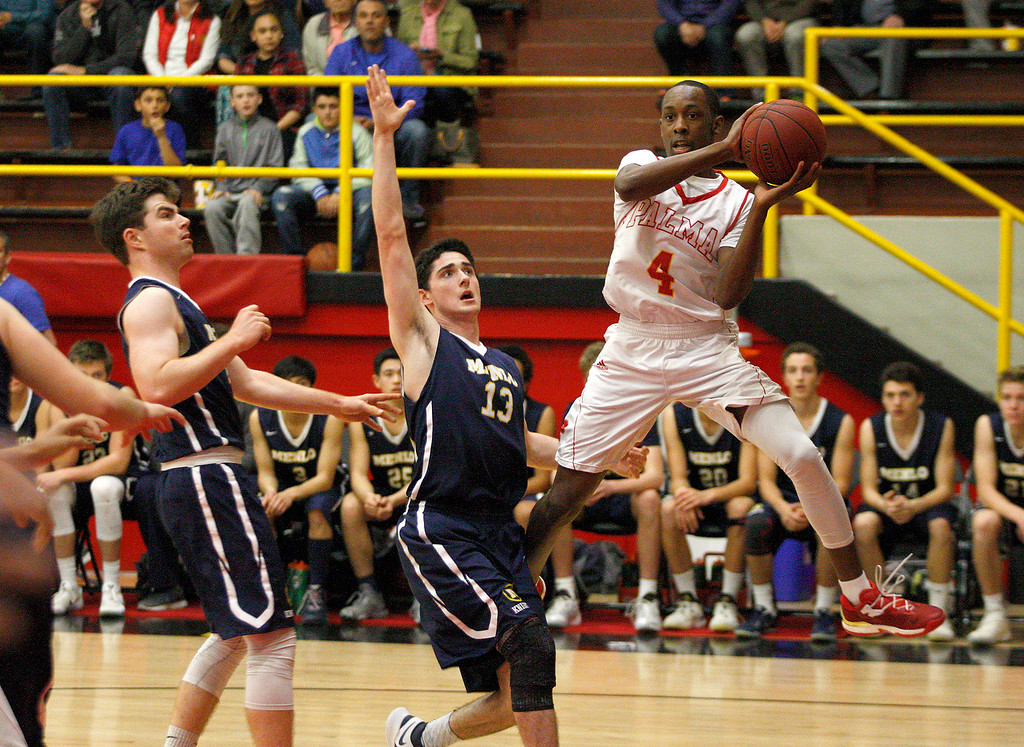. Palma\'s Jamaree Bouyea (4) controls the ball over Menlo School\'s Joe Foley (13) during their second round game of the CIF State Boys Basketball Championships in Salinas on March 11, 2017.  (Vern Fihser - Monterey Herald)