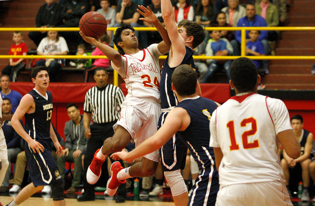 . Palma\'s Nikhil Manimaran (24) makes a shot over drives against Menlo School\'s Hayden Pegley (11) during their second round game of the CIF State Boys Basketball Championships in Salinas on March 11, 2017.  (Vern Fihser - Monterey Herald)