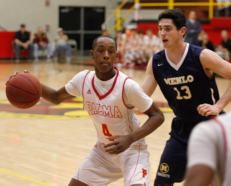 . Palma\'s Jamaree Bouyea (4) drives against Menlo School\'s Joe Foley (13) during their second round game of the CIF State Boys Basketball Championships in Salinas on March 11, 2017.  (Vern Fihser - Monterey Herald)
