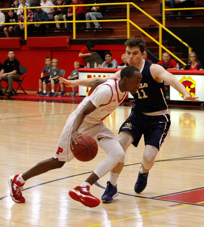 . Palma\'s Jamaree Bouyea (4) drives against Menlo School\'s Hayden Pegley (11) during their second round game of the CIF State Boys Basketball Championships in Salinas on March 11, 2017.  (Vern Fihser - Monterey Herald)