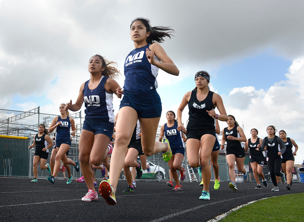 . Notre Dame\'s Maria Aceves leads at the start on her way to a win in the girls 1600 meter race during their track meet against North Monterey County at Palma High School in Salinas on Thursday April 13, 2017. (David Royal - Monterey Herald)