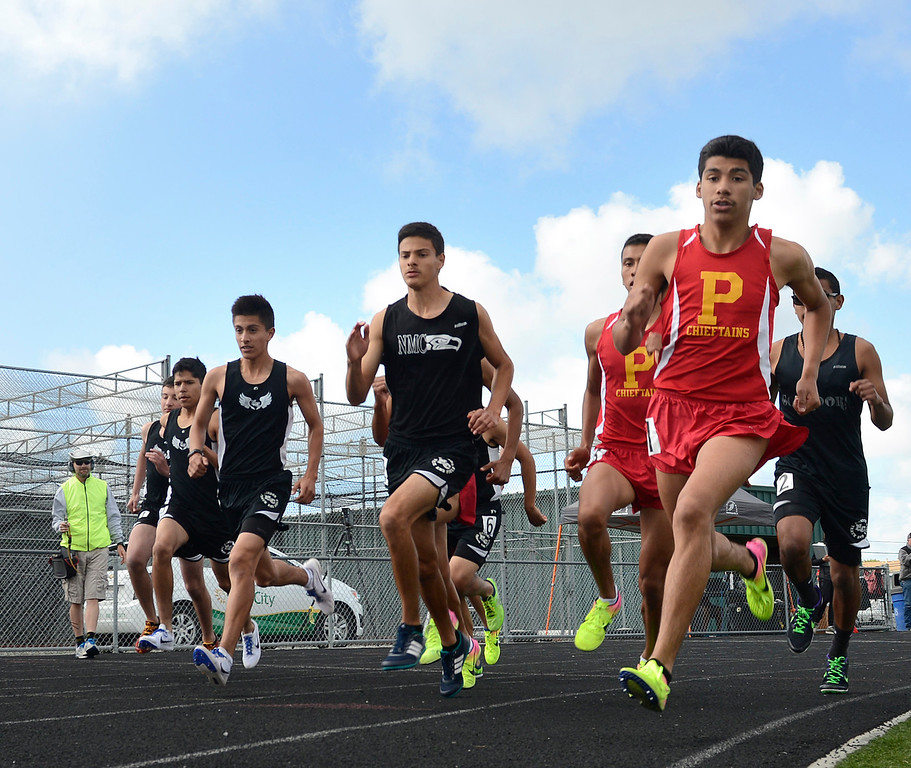 . Palma\'s Thomas Padilla leads at the start of the boys 1600 meter race during a track meet against North Monterey County at Palma High School in Salinas on Thursday April 13, 2017. Padilla won the race, North County\'s Agustin Saldivar. (David Royal - Monterey Herald)