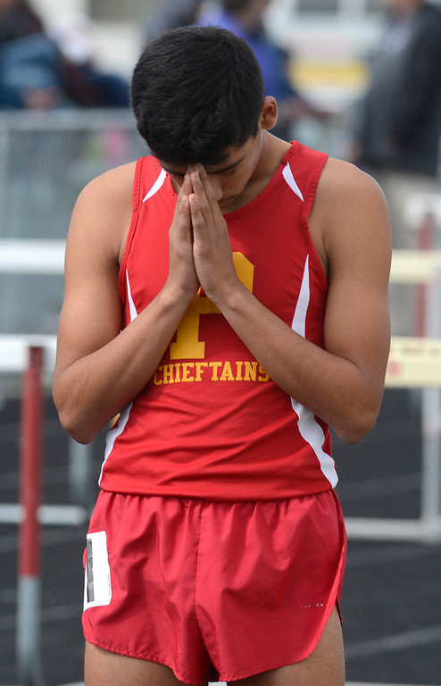 . Palma\'s Thomas Padilla takes a moment before the start of the boys 1600 meter race during their track meet against North Monterey County at Palma High School in Salinas on Thursday April 13, 2017. Padilla won the race. (David Royal - Monterey Herald)