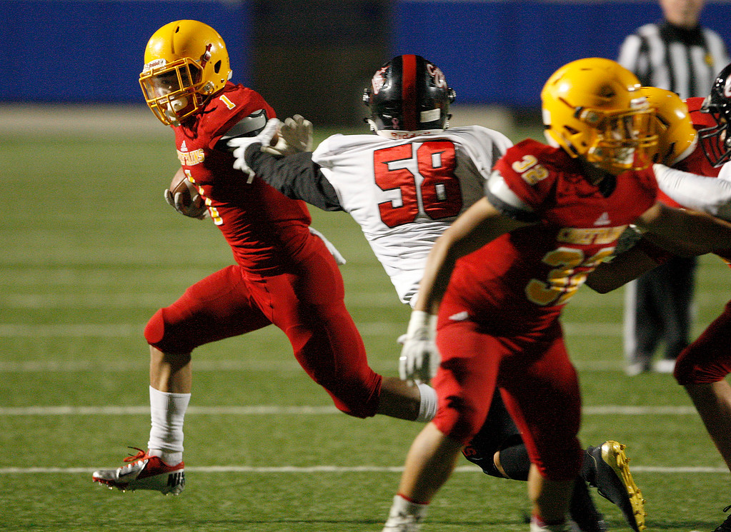 . Palma running back Anthony Villegas (1) avoids Seaside\'s William Huang (58) in the first-half of their game during the CCS Open Division III football playoffs at Rabobank Stadium in Salinas on Friday, Nov. 17, 2017.  (Vern Fisher - Monterey Herald)