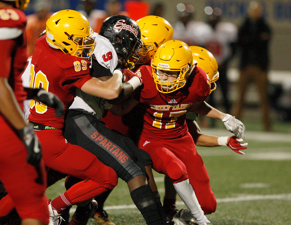 . Palma\'s Kyle Haas (89) and Nathan Leavitt (17) bring down Seaside running back Demarcus Hawkins (9) in the first-half of their game in the CCS Open Division III football playoffs at Rabobank Stadium in Salinas on Friday, Nov. 17, 2017.  (Vern Fisher - Monterey Herald)