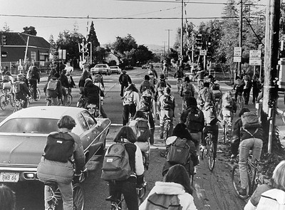 Students on bicycles - intersection and railroad tracks at Alma and Churchill Avenue, l979