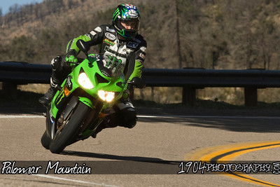A Kawasaki Ninja ZX motorcycle makes its way down South Grade Road on Palomar Mountain.
