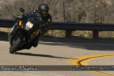 A suzuki GSX-R Hayabusa goes down south grade road on palomar mountain.