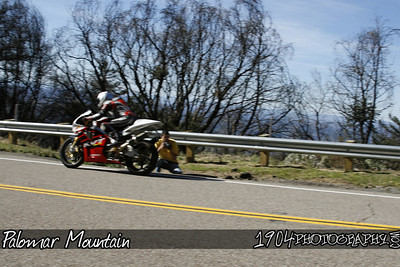 a honda RC-51 heads by one of our photographers and misses by inches as he heads down south grade road on palomar mountain.
