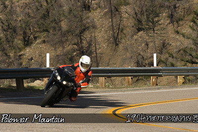A Yamaha R1 motorcycle heads down Palomar Mountain on South Grade Road in San Diego, California.