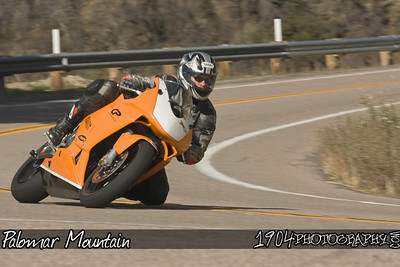 A KTM RC8 Motorcycle rides up and down Palomar Mountain on South Grade Road.