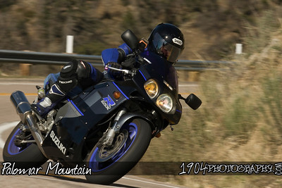 A Suzuki GSX-R Motorcycle heads down south grade road on Palomar Mountain.