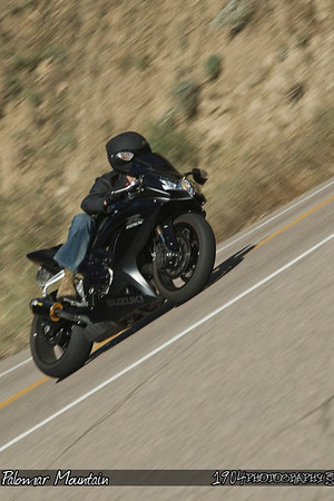 A Suzuki GSX-R heads down south grade road on palomar mountain.