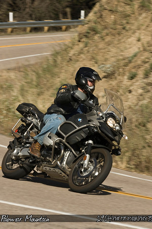 A BMW GS Adventure Touring Motorcycle heads down Palomar Mountain on South Grade Road in San Diego, California.