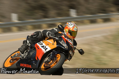 A Honda Repsol replica CBR motorcycle heads down Palomar Mountain on South Grade Road