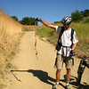 A Gopher snake caught sunbathing on the main trail is helped back into the bush.