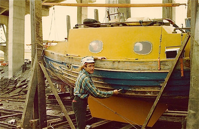 Davy painting the Henry G's hull under the Burrard Street bridge.