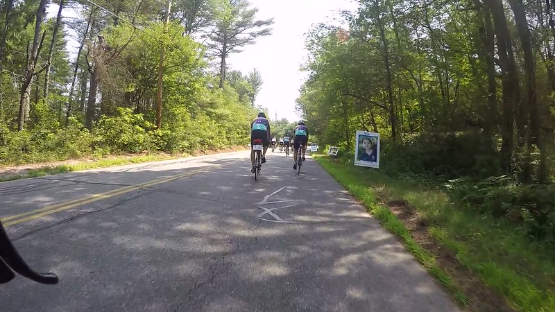Day One of the Pan Mass Challenge. Posters with photos of pedal partners, children currently in treatment, line the course prior to the Pedal Partner water stop