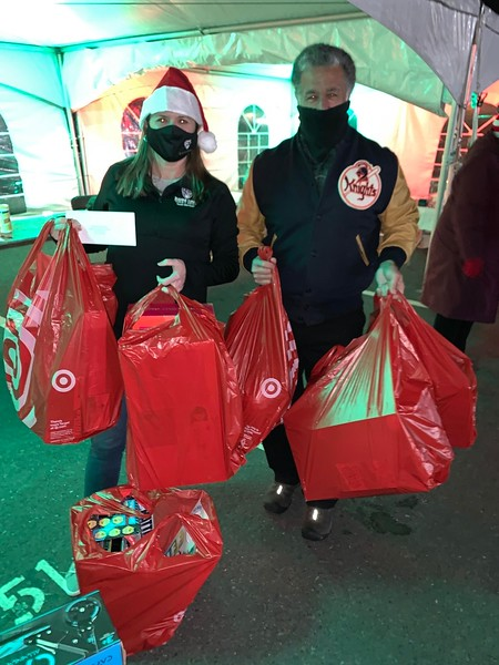 Alison Hughes of Dracut and Steve Panagiotakos collect donations.