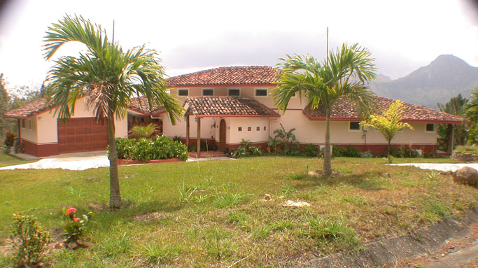 Our house in front showing Royal Palms