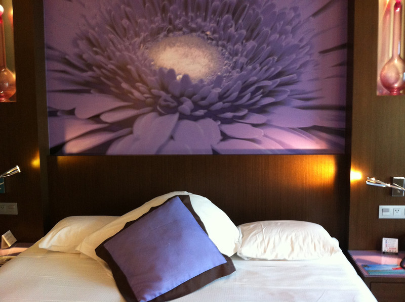 Our room at the riu plaza all in purple and white. Very modern. Green energy wise.  Can't leave the lights on when you leave the room.  The electricity goes on inside when you insert your room key in a special spot inside next to the door.