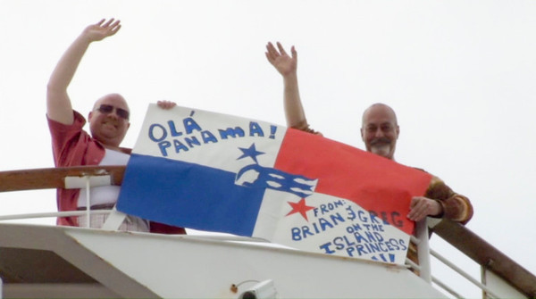"Brian and Greg with their prize-winning sign.  Screen capture from ""Panama with Love"" video."
