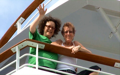 "Von and Barbara waving at the Princess videographer while in canal.  Screen capture from ""Panama with Love"" DVD."