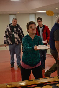 Linda Kerkau - Morning Sun  Santa joined attendees of the flying pancake breakfast in Mt. Pleasant on Saturday, Dec. 2, 2017, and even caught a few pancakes himself.