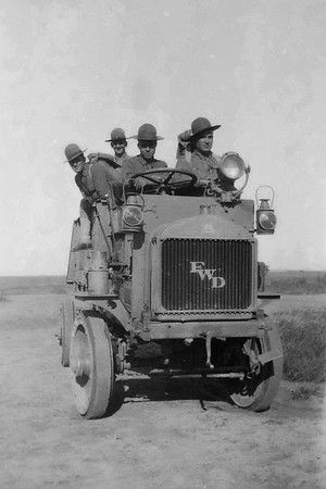 Three soldiers riding in a FWD Model B truck.