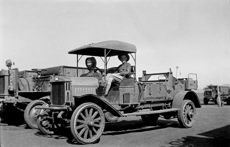 This unusual vehicle is thought to be a Riker. The Loco mobile was renamed Riker at the start of the Pershing Expedition to honor the company?s founder, Mr. Riker.  It has an elongated bed with a middle section door that hinges at the bottom.