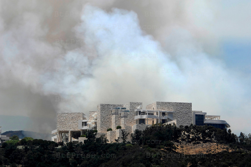 After the panic at the Getty Museum,the firefighters continued efforts this morning to stamp out a slow-moving brush fire near the Sepulveda Pass that burned 80 acres and forced evacuations from the Getty Center and Mt. St. Mary's College. (Photo by Michel Boutefeu)