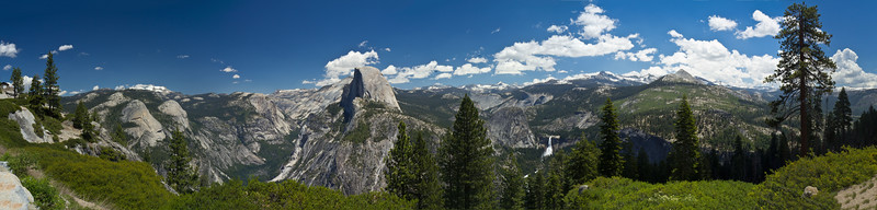 Yosemite Valley viewed from east side of Glacier Point. (Left to right:) Stone viewing house built in 1920s, Mirror Lake, Half Dome, Nevada Falls.