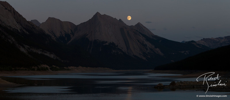 Full moon rises over Medicine Lake (Jasper National Park)