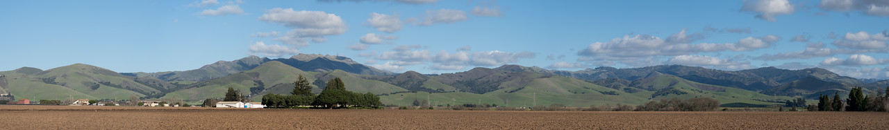 Fremont Peak and the Gabilan Mountains are green from the winter rains.  The row crop fields (foreground), of the Salinas Valley, are bare, awaiting spring, for planting.