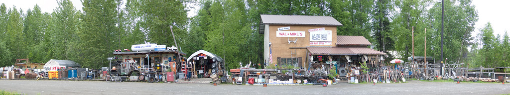 Junk store located on the Parks Road on the way from Anchorage to Denali. Panorama. Trapper Creek