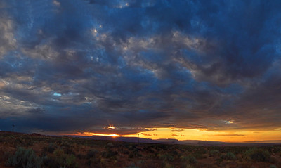 "August 8  From my recent ""Royal Road Trip"" with my friend Queenie.   This sunset was just south of Page, Arizona on July 7.  panorama - 3 verticle shots ******************************************************************************* I returned home from this trip on July 8 and was certainly excited about beginning the process of creating a gallery for the trip and posting some favorites in here.  However, I had some delays to contend with:  on the evening of July 12, I experienced a 'heart attack'  :-(  The ambulance did the lights & siren; they tried to do an angioplasty and could not due to sharp s-turns in the blood vessle where there was a slight blockage; I got to spend a couple of days in ICU and 5 more days in the step-down unit before being released to go home.  I'm being treated with medication, which is apparently doing a good job as the cardiologist was pleased with my recent nuclear stress test results!  He then gave me the go ahead to begin exercising which I started today at cardio rehabilitation under monitored conditions. I haven't spent much time working with the trip photos, or anything else superfluous for that matter :-( I am ever-so-grateful to still be here, that I am doing better and that this incident DID NOT take place during our road trip! ***Thanks for asking, Godschild!"