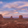 Panorama of sunset over the West and East Mittens Buttes in Monument Valley Navajo Tribal Park on the Arizona / Utah border