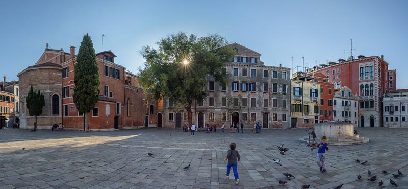 Children playing near Chiesa di San Polo, Campo San Polo, Venice, Italy