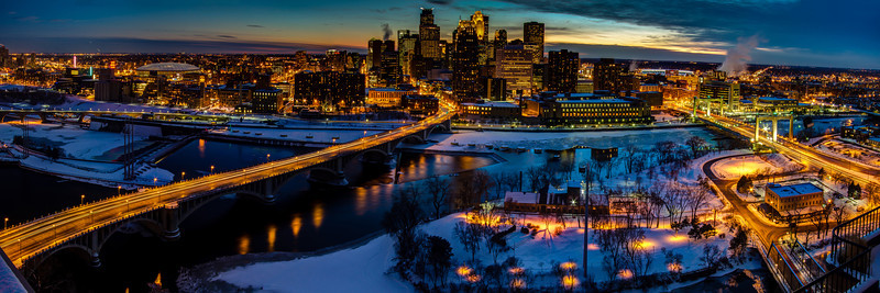 Bird's eye view of the Minneapolis skyline and Mississippi riverfront at dusk on a frigid winter's night.  From the Metrodome and Guthrie Theater to Target Field, from the sweeping 3rd Avenue bridge to the classical Hennepin Avenue bridge, this stunning image is truly representative of this great city.