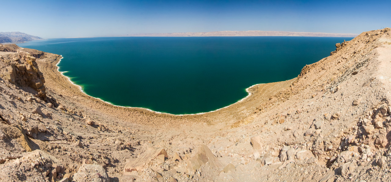 A panorama of the Dead Sea as seen from high up a cliff on the Jordan side of the sea.