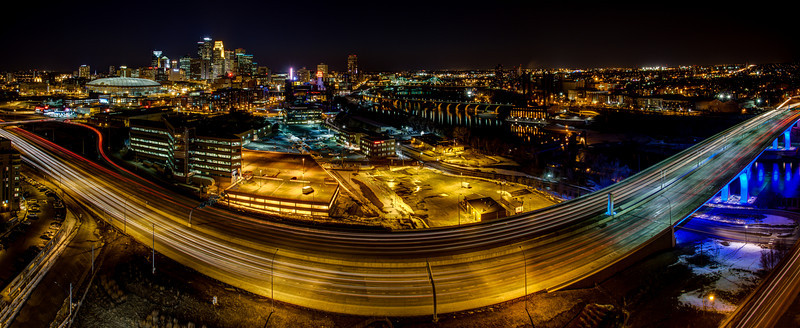 Bending Freeway - This unique perspective on the downtown Minneapolis skyline and Mississippi river highlights the newly reconstructed 35W freeway bridge as it bends beneath your feet from this bird's eye view 200' above the roadway.