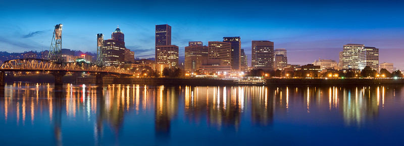 Dusk on a beautiful night in Portland Oregon. The skyline is reflected on the Willamette River.