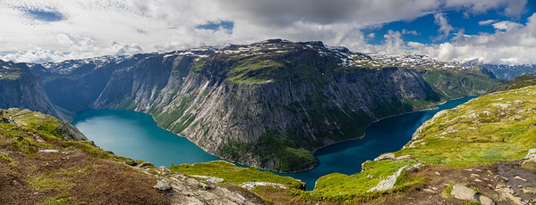Hiking route to Trolltunga near lake valley and mountains
