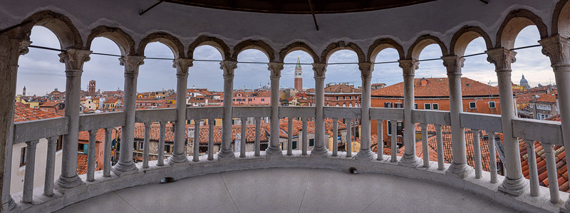 Panorama and view of San Marco Campanile from the top of Scala Contarini del Bovolo near Campo Manin, Venice, Italy