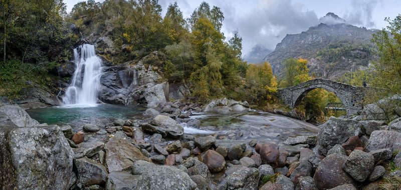 Panorama of Devil's Waterfall and Roman bridge over Chiusella Creek in Fondo di Traversella near Ivrea, Piedmont, Northwestern Italy